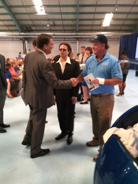 EV Fleet Brooks Agnew shakes hands with NC Gov. Pat McCrory during the opening of ReVenture Park.